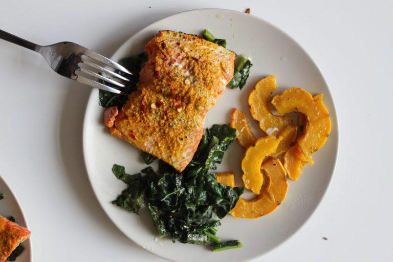Sheet pan salmon on a white plate.