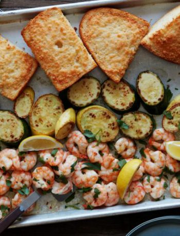Sheetpan Shrimp Scampi spread out on a pan.