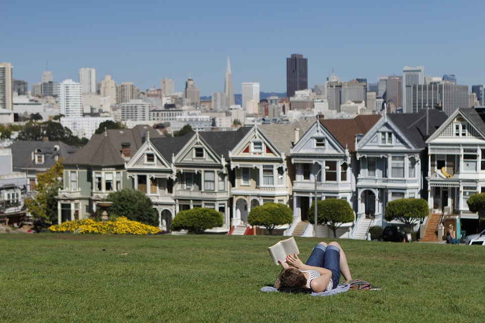 A woman reading in a park in San Francisco.