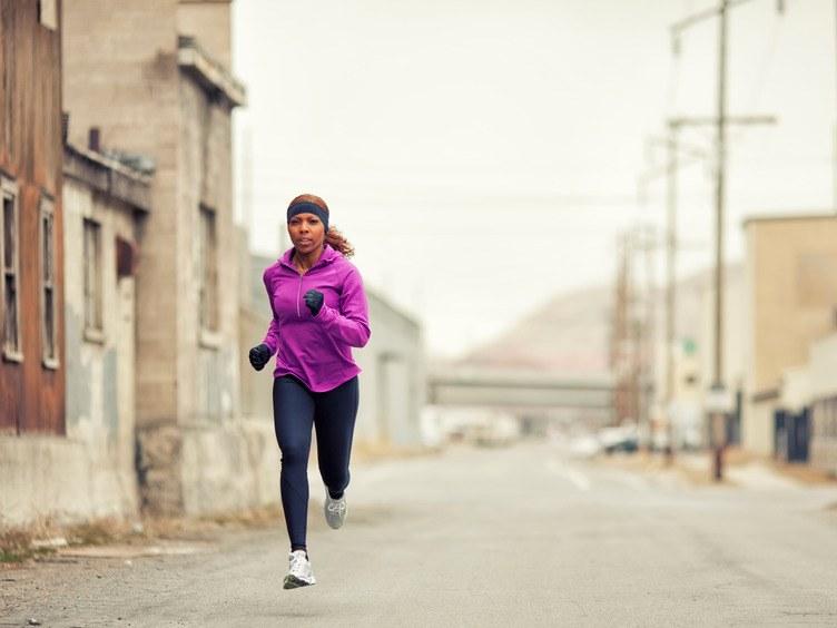 Woman jogging in an urban setting.