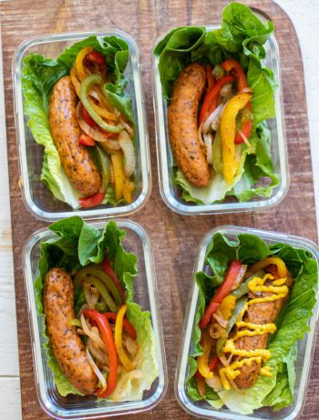Sausage wraps in lettuce in containers.