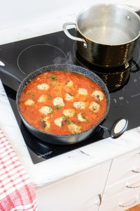 Preparing Italian Cuisine on an Induction Cooktop