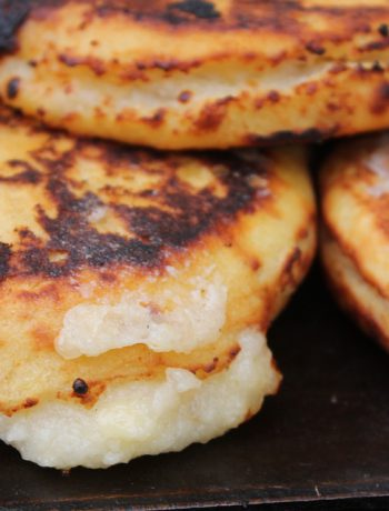 Arepas stacked upon one another.