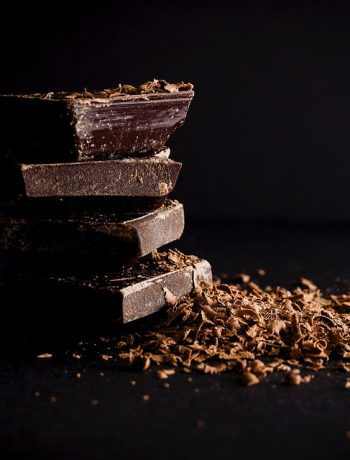 Dark chocolate stacked upon one another.