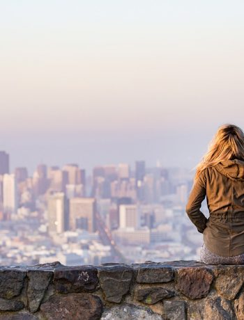 Woman overlooking city landscape.