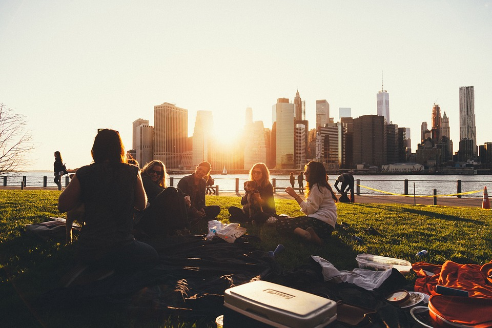 A group of friends enjoying a picnic in an urban setting.