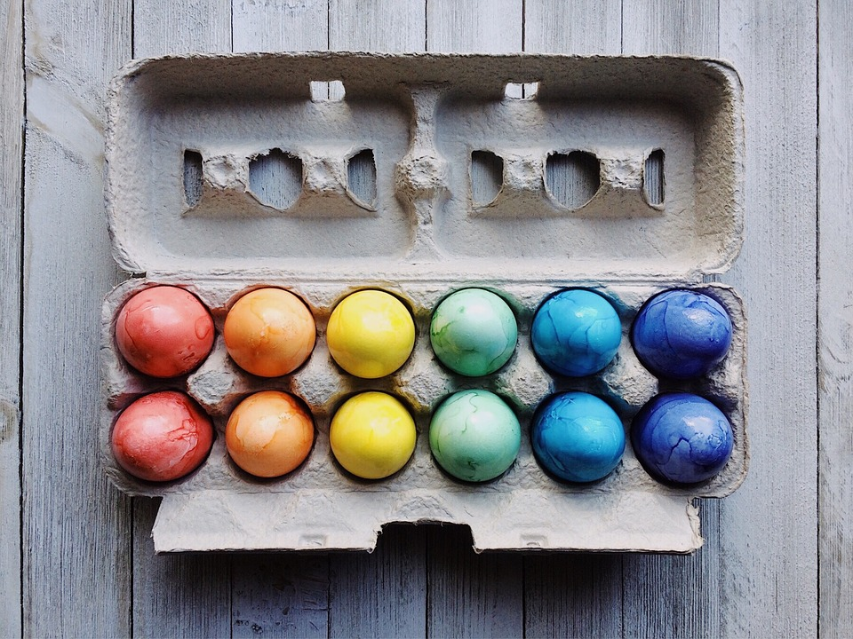 Dyed eggs in a carton.