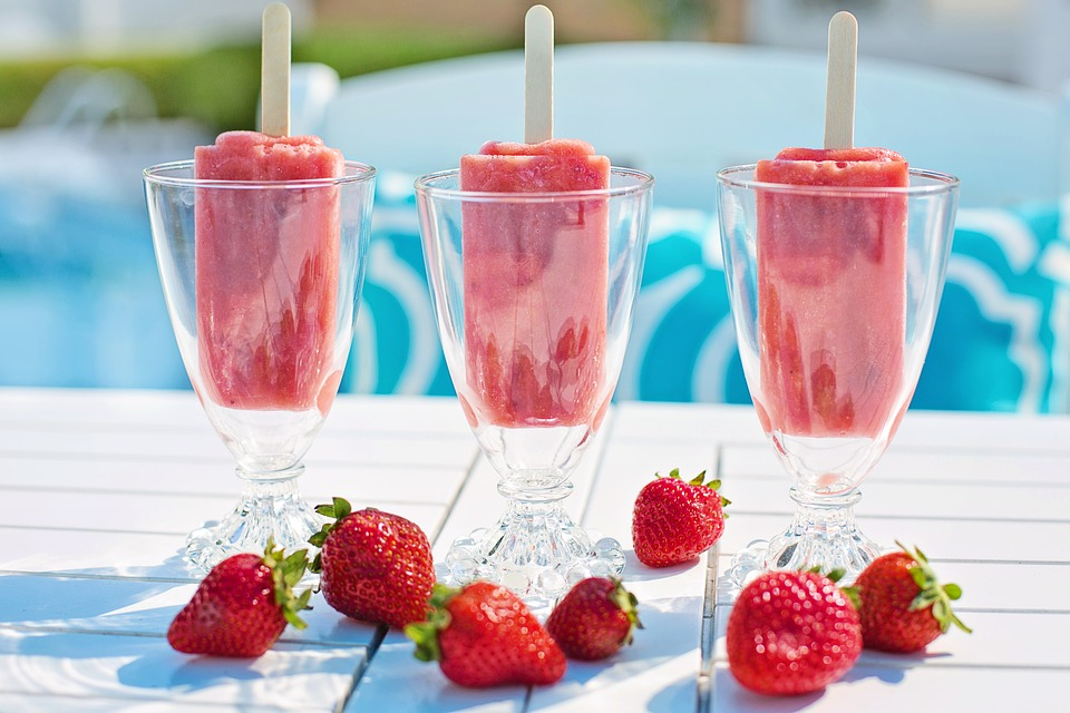 Three frozen strawberry drinks.