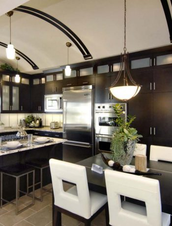 Modern dark kitchen design with curved ceiling.