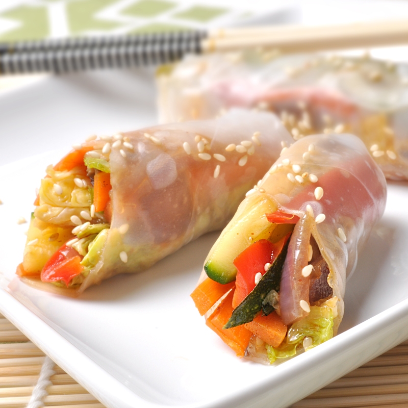 Spring rolls on a white plate.