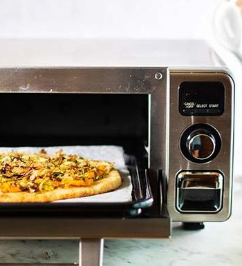 Pizza being prepared in a Sharp Supersteam Countertop Oven.
