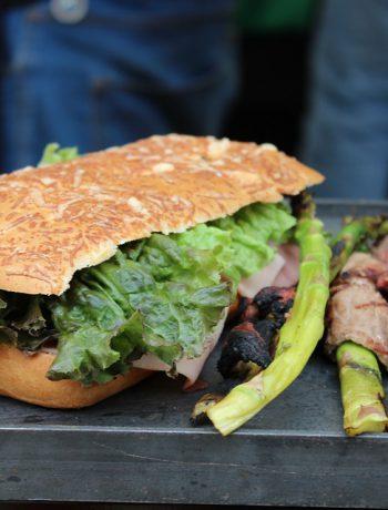 Bistro steak sandwhich on a hard outdoor surface.