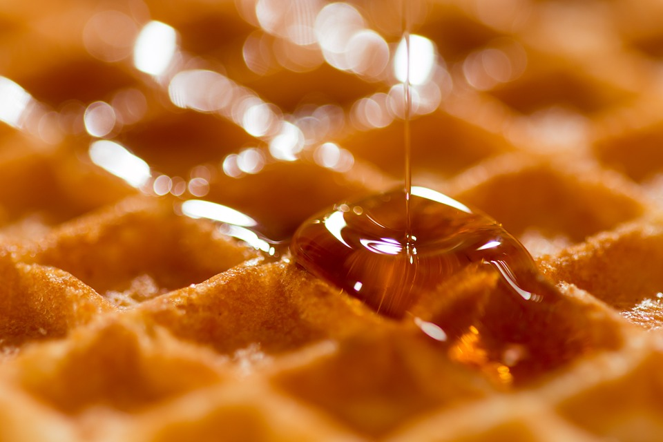 Gluten Free Belgian Waffle with syrup being poured.