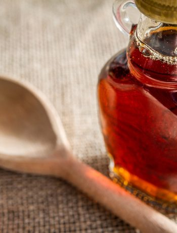 Homemade Pancake Syrup next to a wooden spoon.