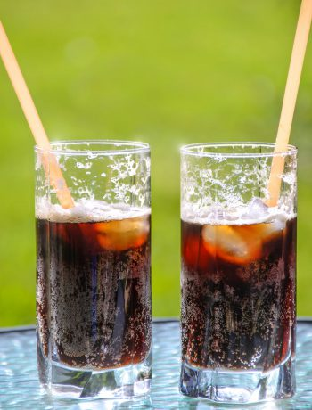 Homemade soda in two glasses outdoors.