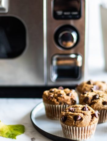 Chocolate chip muffins next to a Sharp Supersteam Countertop Oven.
