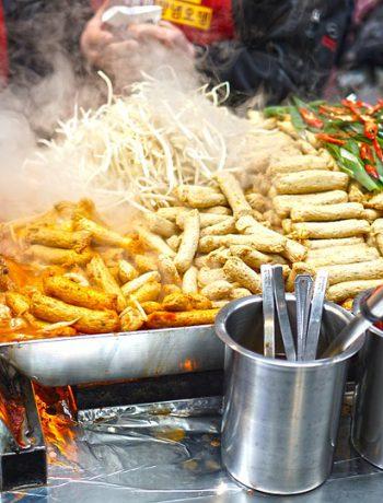 An array of foods at a street fair.