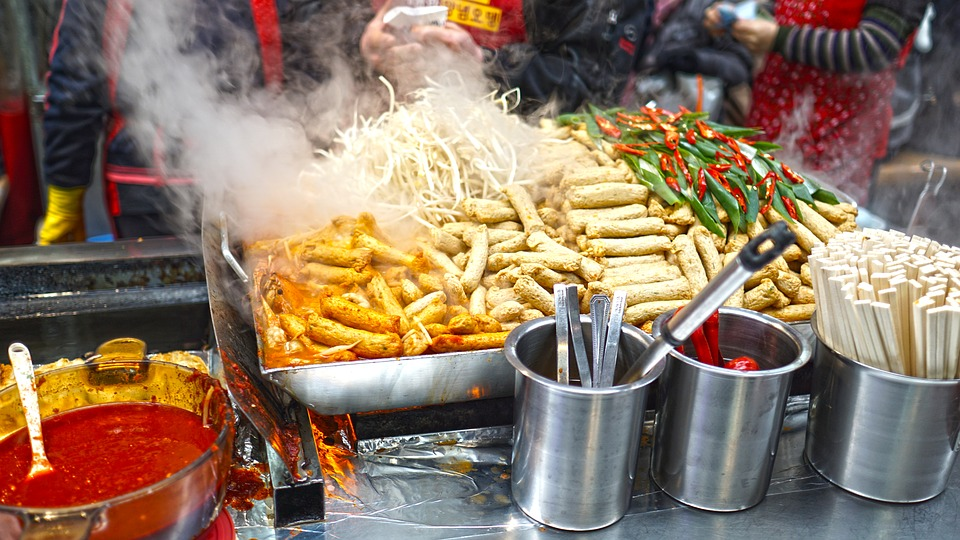 An array of foods at a street fair.