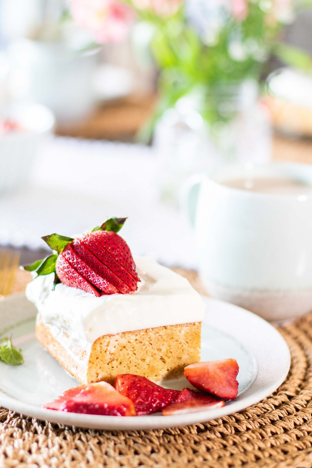 Tres Leches with strawberry on a plate.