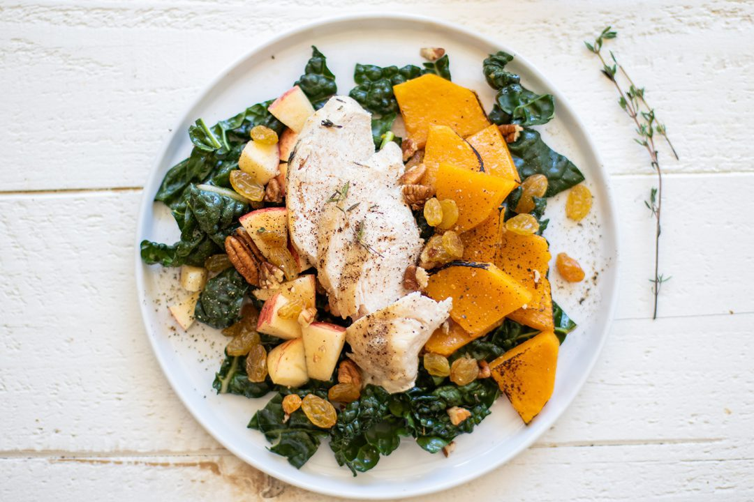 Autumn Chicken and Kale Salad prepared on a white dish.