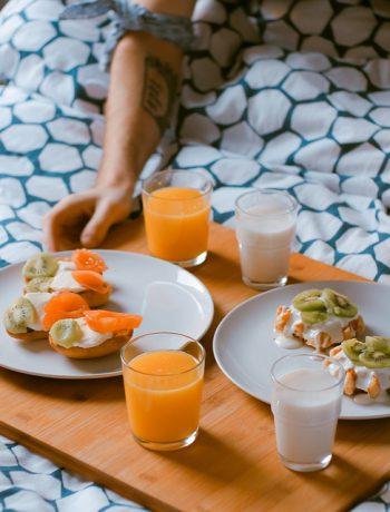 Breakfast being prepared to be eaten in bed.