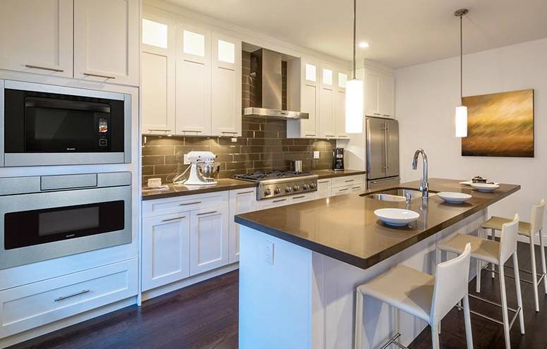 White kitchen design with grey subway tile.
