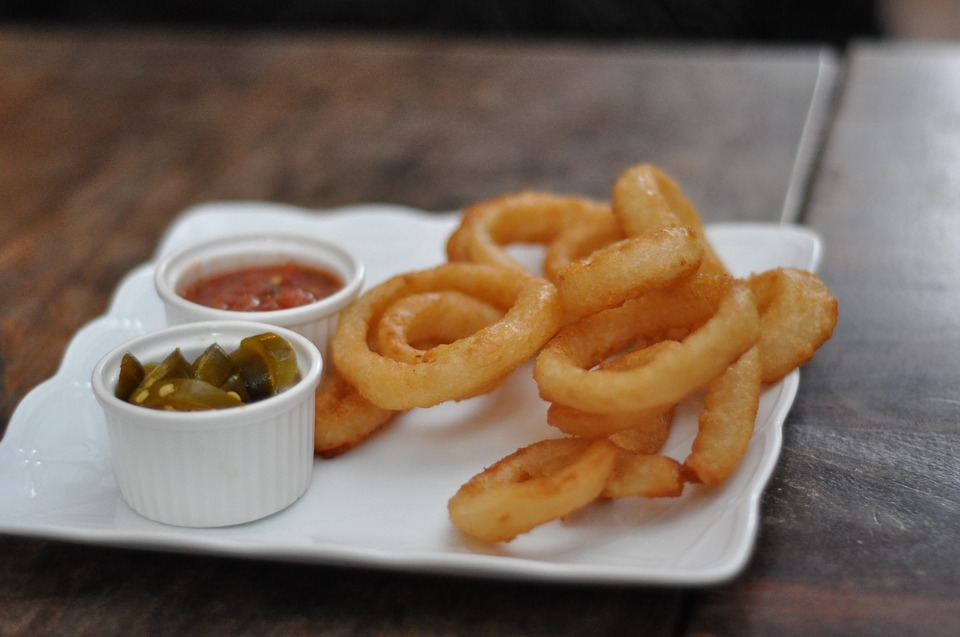 Old Fashioned Onion Rings on a plate with dips.