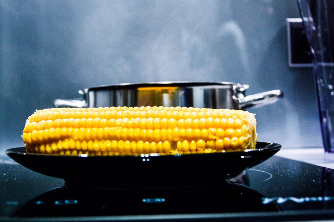 Corn being cooked on a Sharp Induction Cooktop.