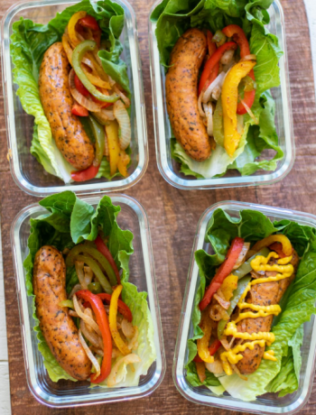 Four sausage wraps in containers with sides.