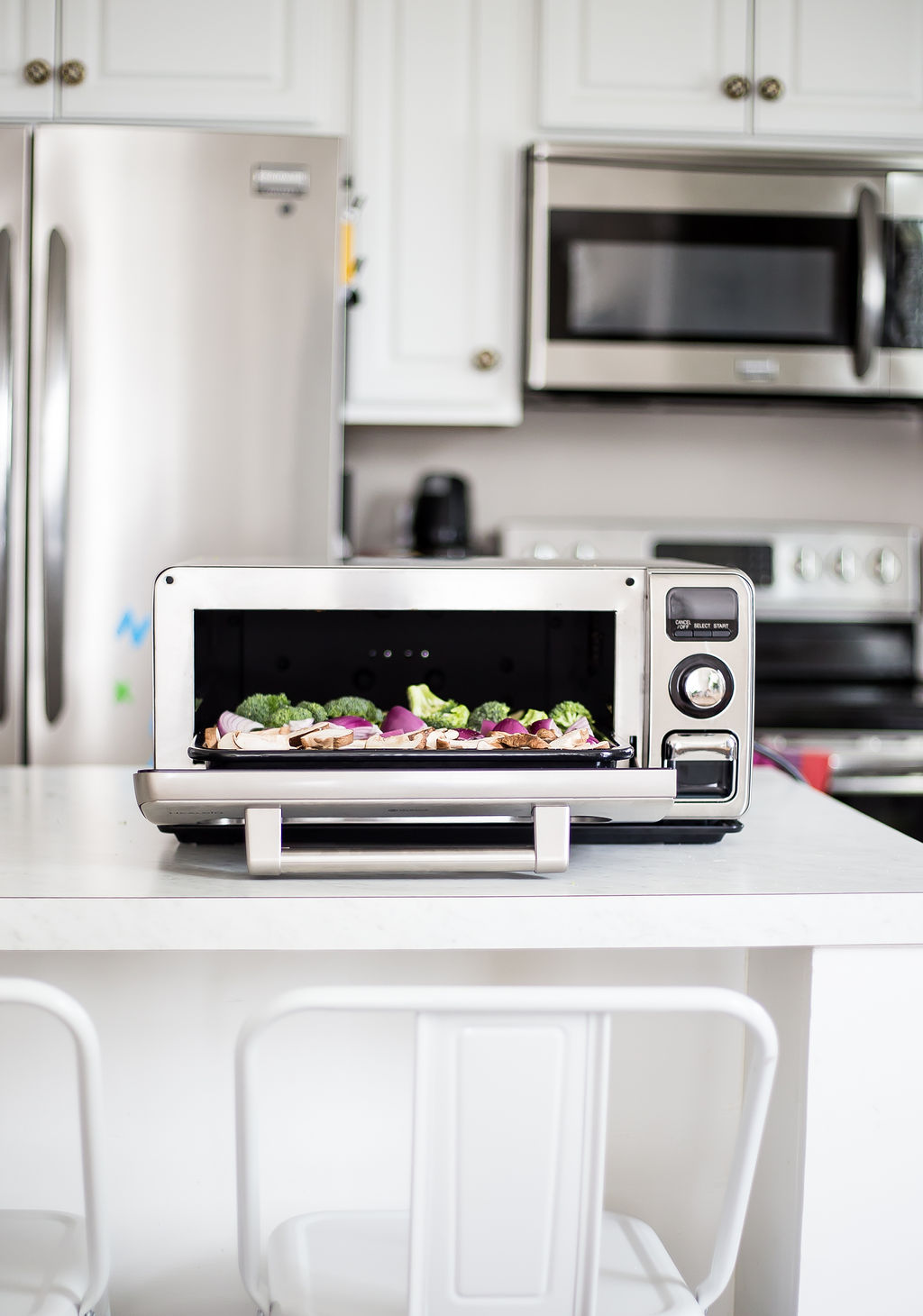 Sharp Supersteam Countertop Oven on a white kitchen island.