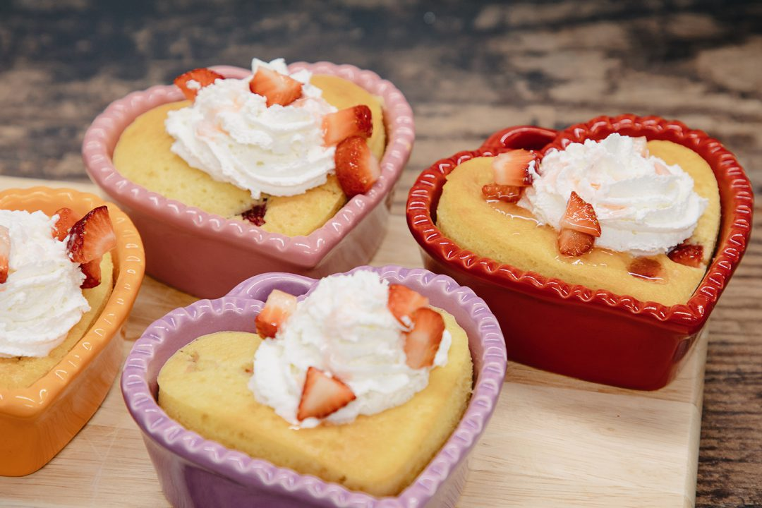 Heart-Shaped Strawberry Shortcakes with whipped cream and strawberry toppings.