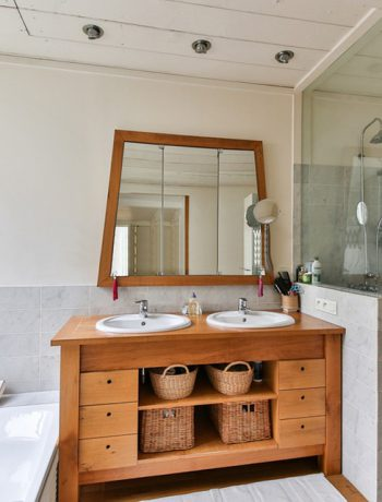 Master bathroom with dual sinks and tub.