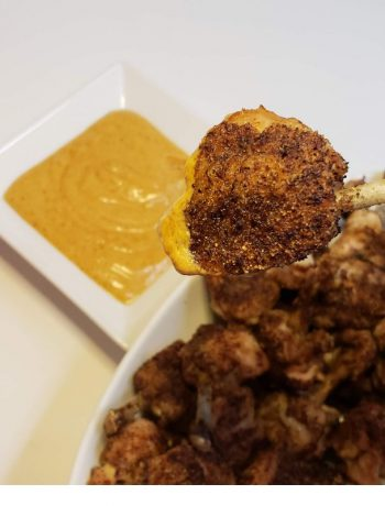 Chicken Lollipops being dipped into a Homemade Aioli Sauce