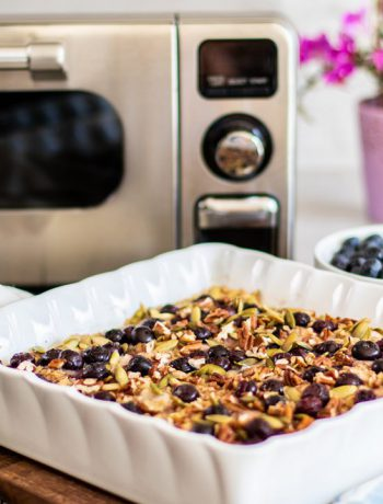 Blueberry Baked Oatmeal in a square dish next to a Sharp Supersteam Countertop Oven.