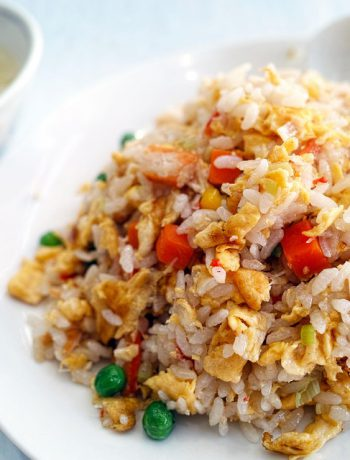 Chicken Fried Rice on a place next to a bowl of rice.