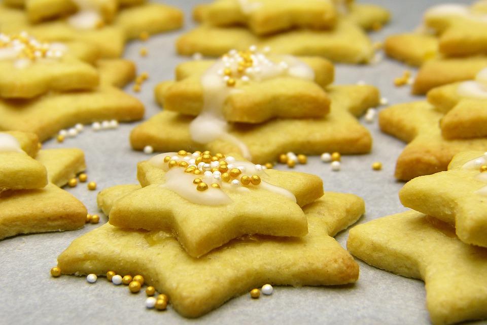 Lemon sugar cookies spread apart with sprinkle balls.