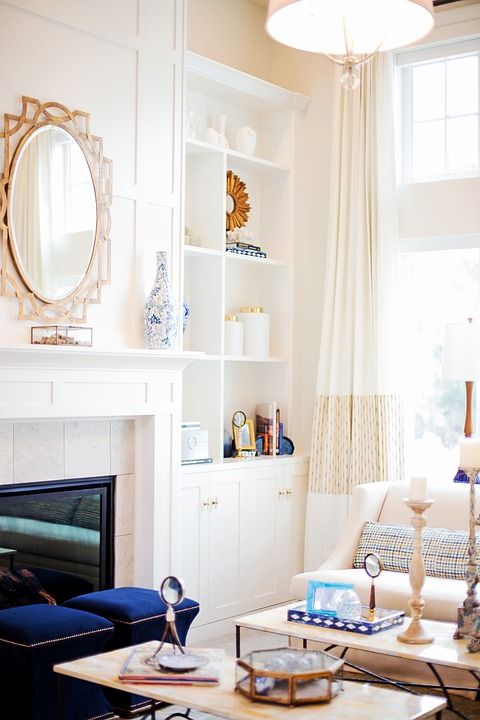White and blue living room design with a fireplace.