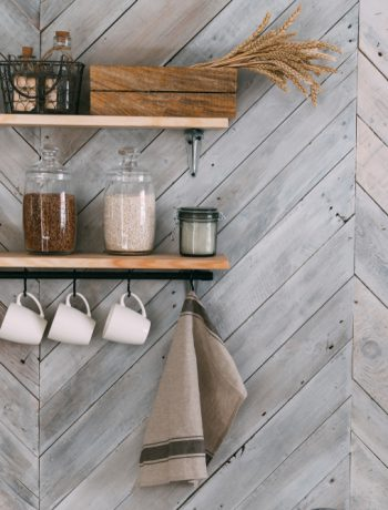 Modern shelving design holding kitchen products on a wooden wall.