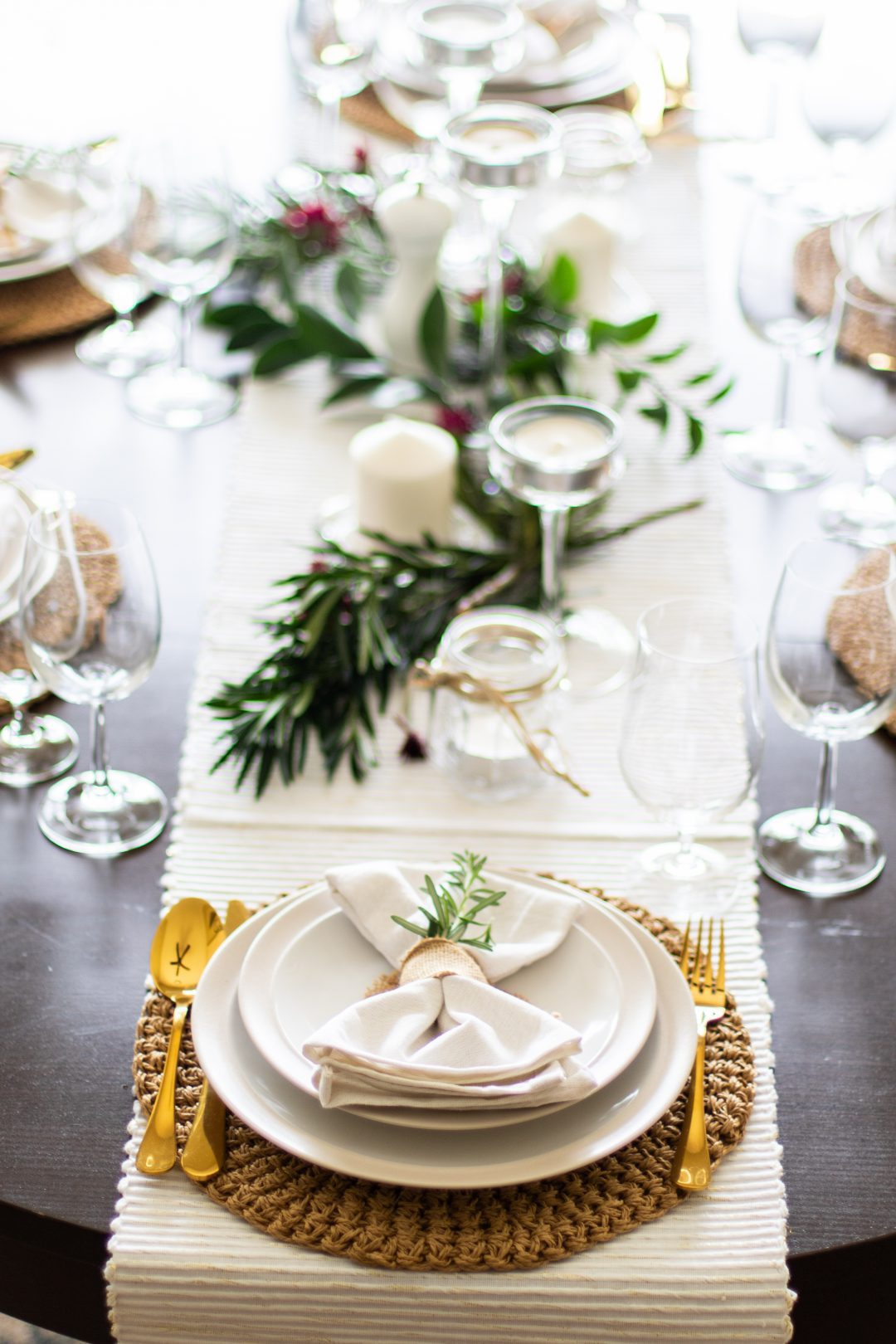 Table setting with glass and gold silverware.