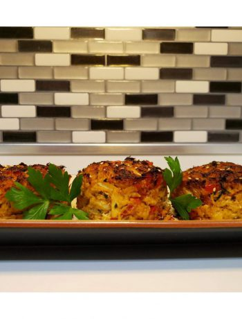 Crab cakes on a tray on a countertop.