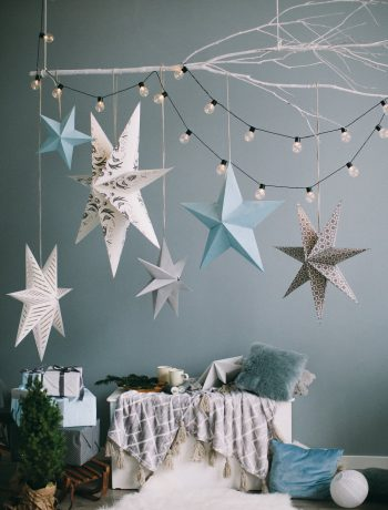 Stars, lights, and pillows next to wall decor.