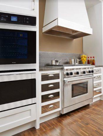 White kitchen design with mirrored cabinets.
