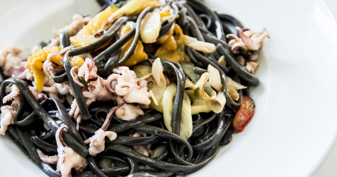 Gluten Free spaghetti mixed with seafood.
