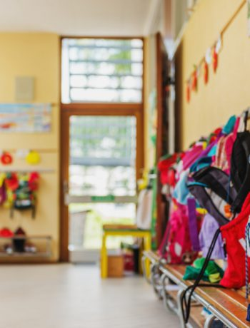 School setting with childrens coats and accessories.