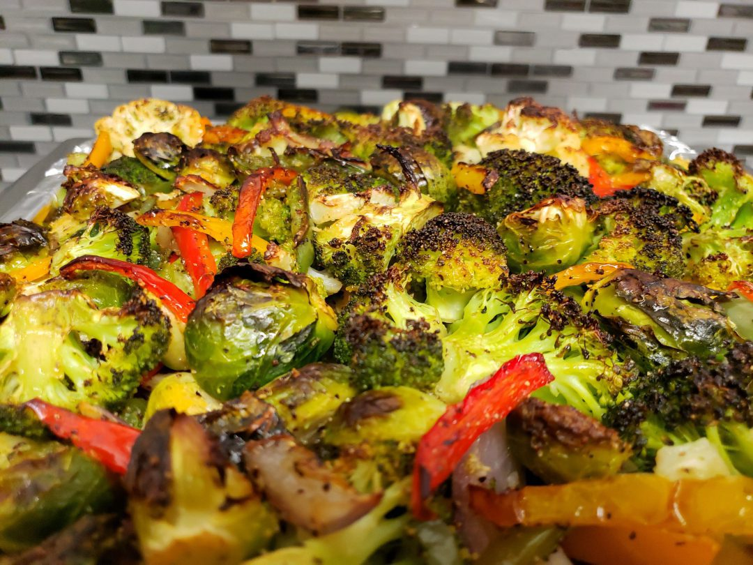 Halibut steak with vegetable toppings.