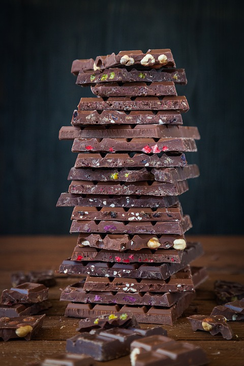 Homemade chocolate stacked upon one another.