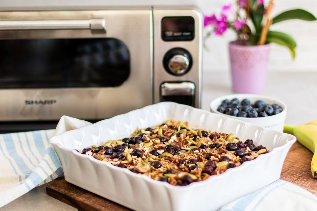 Square dish with blueberries and granola in a Sharp Countertop Oven.