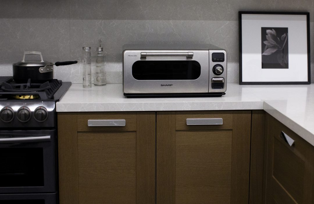 Sharp Countertop Oven on a top of a white countertop.