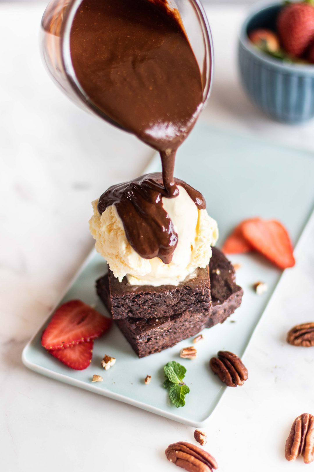 Chocolare drizzle on ice cream scoop and fudge.