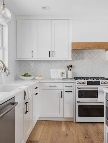 White kitchen design with Sharp Microwave Drawer in an island.